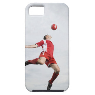 Soccer player and soccer ball in mid-air iPhone 5 cases
