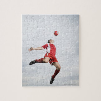 Soccer player and soccer ball in mid-air jigsaw puzzle
