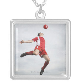 Soccer player and soccer ball in mid-air silver plated necklace