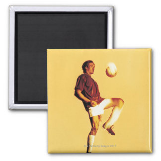 soccer player bouncing ball off knee 2 inch square magnet