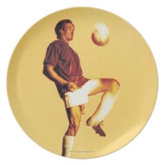 soccer player bouncing ball off knee melamine plate