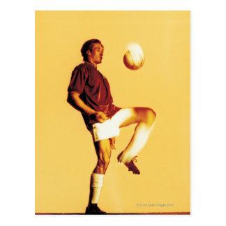 soccer player bouncing ball off knee postcard