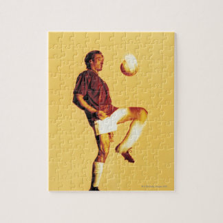 soccer player bouncing ball off knee puzzles