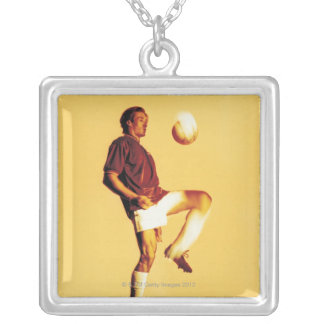 soccer player bouncing ball off knee silver plated necklace