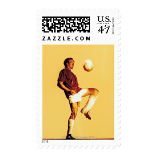 soccer player bouncing ball off knee stamp