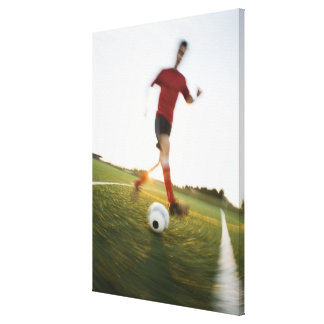 Soccer player dribbling ball stretched canvas print