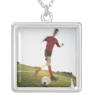 Soccer player dribbling ball square pendant necklace