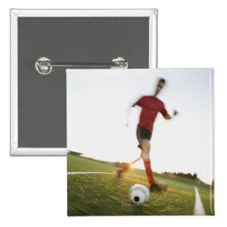 Soccer player dribbling ball pinback button