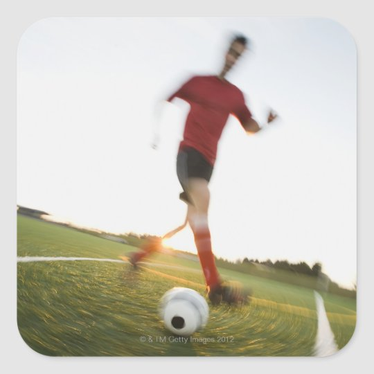 Soccer player dribbling ball square sticker