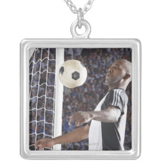 Soccer player facing mid air ball in goal mouth silver plated necklace