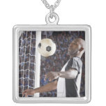 Soccer player facing mid air ball in goal mouth square pendant necklace