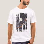 Soccer player facing mid air ball in goal mouth T-Shirt
