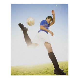 Soccer player jump kicking poster