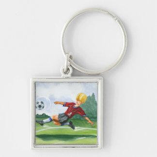 Soccer Player Kicking a Ball by Jay Throckmorton Key Chain