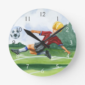 Soccer Player Kicking a Ball by Jay Throckmorton Round Clock