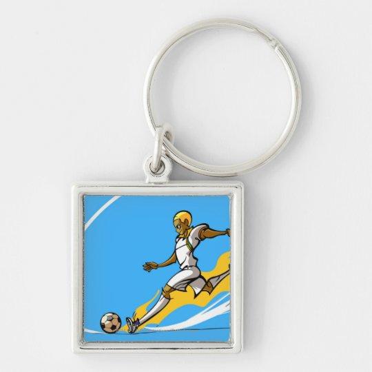 Soccer player kicking a soccer ball keychain