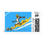 Soccer player kicking a soccer ball stamps