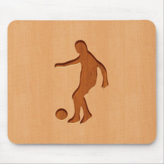 Soccer player silhouette engraved on wood design mouse pad