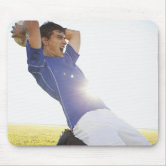 Soccer player throwing ball mouse pad