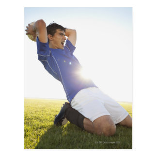 Soccer player throwing ball postcard