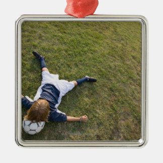 Soccer player with head on football metal ornament