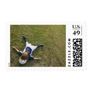 Soccer player with head on football postage