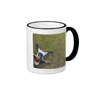 Soccer player with head on football ringer coffee mug