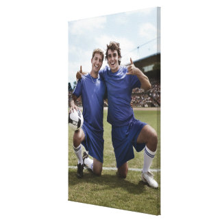 Soccer players cheering canvas print