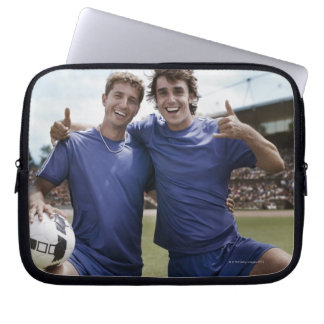 Soccer players cheering laptop sleeve