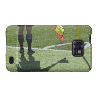 Soccer referee holding flag. galaxy SII cases