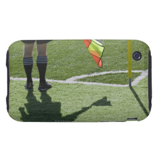 Soccer referee holding flag. iPhone 3 tough covers