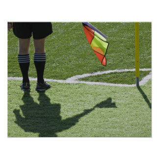 Soccer referee holding flag. poster