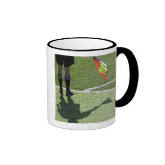 Soccer referee holding flag. ringer mug