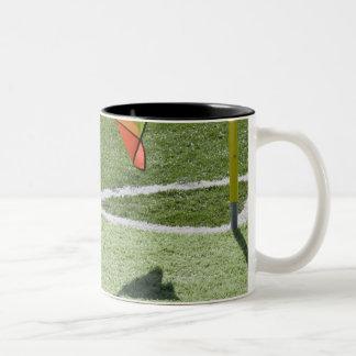 Soccer referee holding flag. Two-Tone coffee mug
