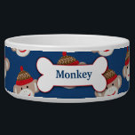 "Sock Monkey Custom Pet Dog Food Bowl - Blue<br><div class=""desc"">This customizable sock monkey pet food bowl features a blue background and lots of sock monkeys! The dog bone in the center has an example name,  &quot;Monkey&quot;,  but you can change it to any name.</div>"