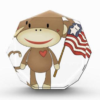 Sock monkey with flag awards
