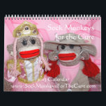 """Sock Monkeys for the Cure Wall Calendar<br><div class=""""desc"""">All of the Sock Monkeys for the Cure were created in honor or memory of brave fighters against their own breast cancer. Each has her own personality and style in this &quot;pin-up&quot; calendar! Thank you for your purchase this calendar from our Sock Monkeys for the Cure shop. 50% or more...</div>"""