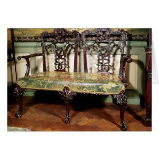 Sofá tallado, con el asiento de la tapicería, simi tarjeta de felicitación