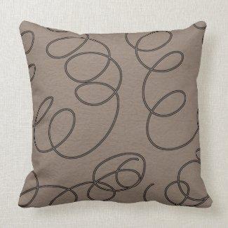 soft brown decorative swirls pillow