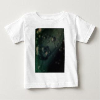 Soft green bubbles on natural metallic finish tee shirt