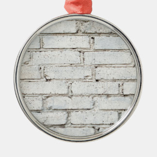 Soft image of a background of gray brick wall metal ornament