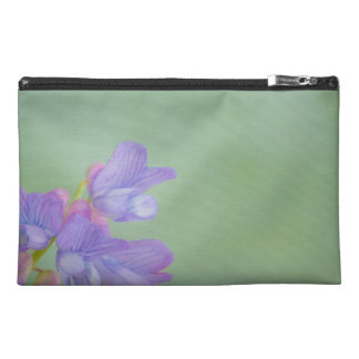 Soft Purple Wild Flowers with a Green Background Travel Accessories Bag