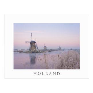 Soft sunrise light in winter over windmills postcard