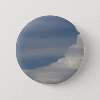 Soft white clouds against blue sky background button