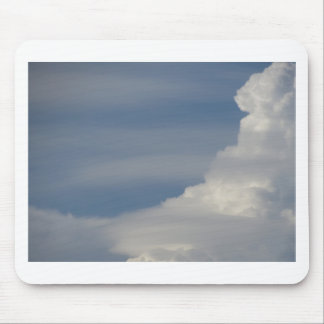 Soft white clouds against blue sky background mouse pad