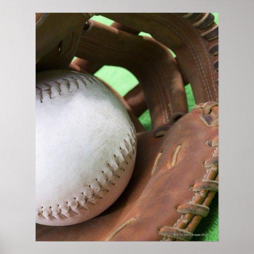 Softball in catcher's glove poster