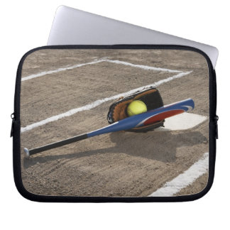 Softball, softball glove and bat at home plate laptop sleeve