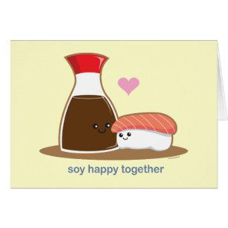 Soja feliz junto tarjeta de felicitación