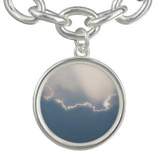 Sol detrás de las nubes pulseras con dijer
