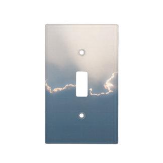 Sol detrás de las nubes placa para interruptor